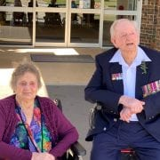 Anzac Day services -Lyall and Beryl watching the flag raising