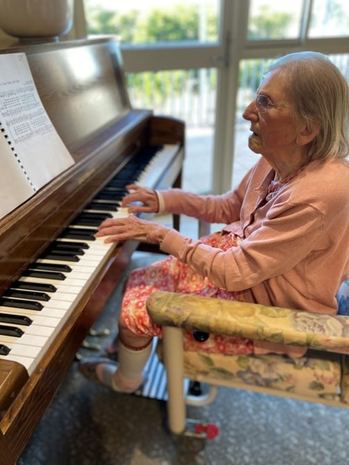 One of our residents playing the pianot playing the piano